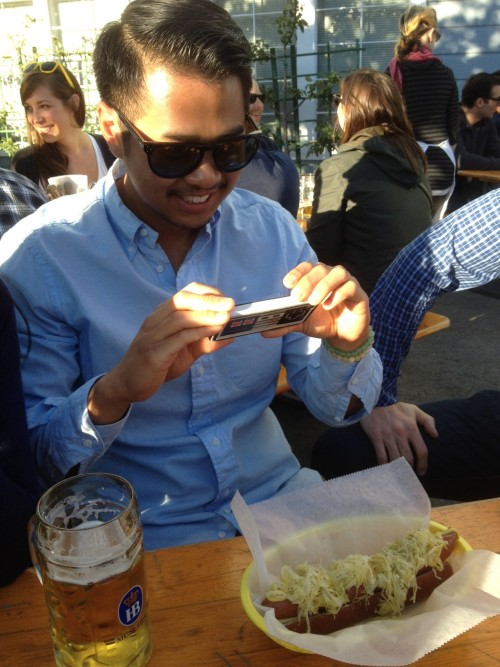Azn taking a pic of his sausage @ Biergarten in Hayes Valley, SF. (Azn in photo runs food blog foodhipster206.com)