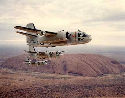 Grumman S-2 Trackers of the RAN Fleet Air Arm in formation over Uluru/Ayers Rock