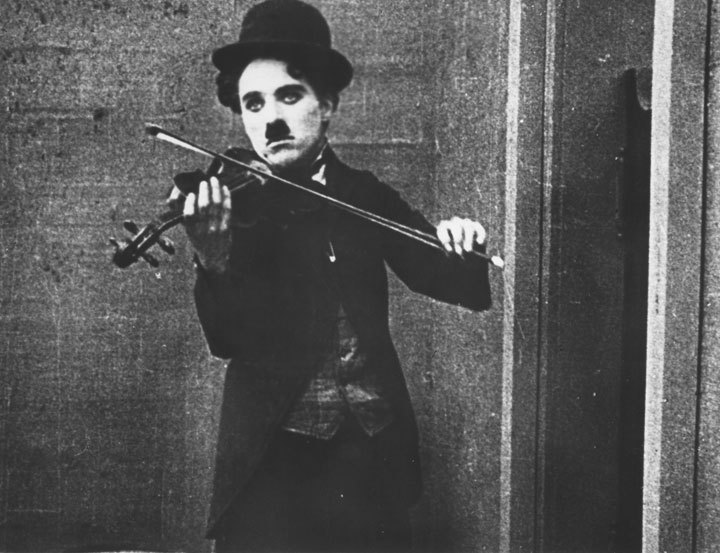 fuckyeahchaplin:  Charlie busks in a saloon on his violin in The Vagabond Mutual c.1916