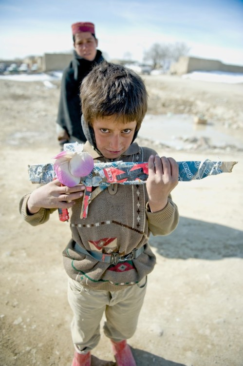 Afghan Boy With Wooden Rifle by Alex Manne