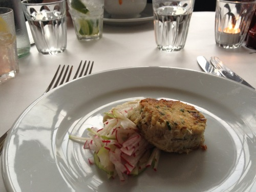 A delicious crab cake starter with radish salad at Bistroteque