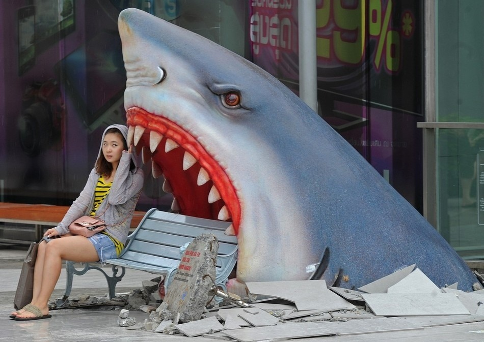 ianbrooks:  Shark Bench In Thailand, the sharks dont even wait for you to get in the water.  (photo by Pornchai Kittwongsakul / via: Buzzfeed)