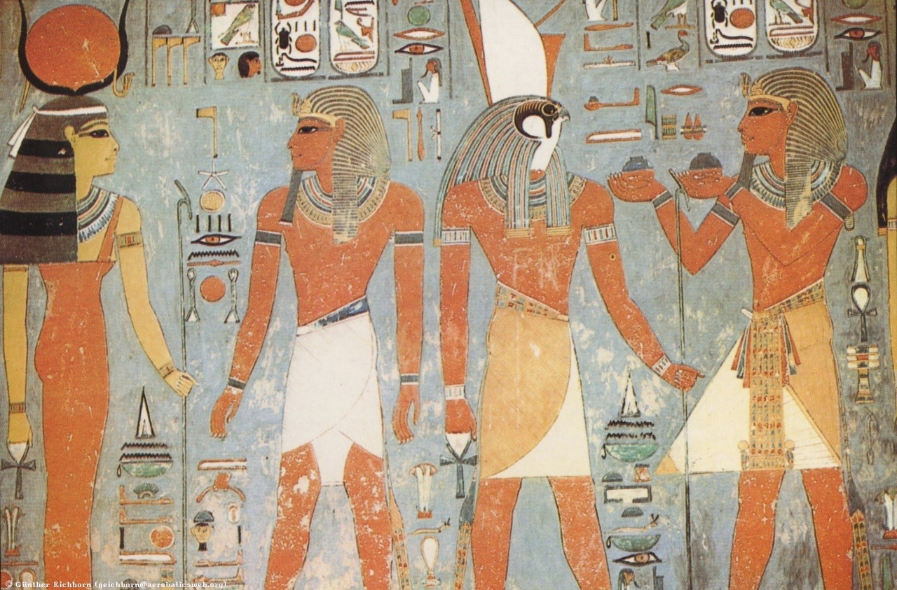 ancientart:  Ancient Egyptian painting in the Tomb of Horemheb, showing the Goddess Hathor (left) and her husband Horus (center right). 19th Dynasty.