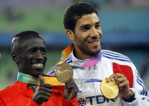 OLYMPIC  FOCUS: Ezekiel Kemboi Cheboi (left) Born May 25, 1982, Ezekiel Kemboi Cheboi is a Kenyan athlete, winner of the 3000 metres steeplechase at the 2004 Summer Olympics, the 2009 World Championships and the 2011 World Championships. He became African Junior Champion in 2001 and came to prominence with a silver medal at the 2002 Commonwealth Games. Kemboi established himself as one the world's foremost steeplechasers with a win at the 2003 All-Africa Games, a silver at the 2003 World Championships in Athletics, and then becoming the 2004 Olympic Champion. Over the next three years he obtained two more world silver medals and won at the 2006 Commonwealth Games. Kemboi represented Kenya at the 2008 Beijing Olympics but managed only seventh – his worst performance on the global stage. He rebounded with a win at the 2009 World Championships (his first world gold medal) and took silver at the 2010 African Championships the following year. His 3000 m steeplechase best of 7:58.85 places him as the seventh fastest of all time. He is one of only three men to have won both Olympic and World golds in the event, along with Reuben Kosgei and Brimin Kipruto