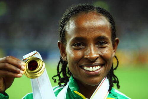 OLYMPIC  FOCUS: Meseret Defar Tola Born 19 November, 1983 in Addis Ababa, Meseret Tola is a female long-distance runner from Ethiopia who competes chiefly in the 3000 metres and 5000 metres event, and has twice won medals at the Olympic games: gold in the 5000m at the 2004 Athens Olympic Games and bronze in the same race at the 2008 Beijing Olympics.  Defar holds the indoor records for the 5000 metres, 3000 metres and two-mile run. She has dominated the 3000 m indoor event, winning the three consecutive gold medals at the IAAF World Indoor Championships.