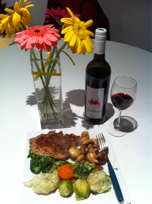 Romantic (overlook the wilting flowers please), steak dinner for one.  Don't mind if I dooo