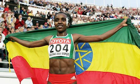 "OLYMPIC  FOCUS: Tirunesh Dibaba Born October 1, 1985 in Bekoji, Arsi, Ethiopia, Dibaba is the current Olympic 5000 metres and 10,000 metres champion, and the outdoor 5000 metres world record holder. She has also won four world track titles and five world cross country titles. At the Olympic games, she won gold at the Beijing tournament in both the 5000m and 10, 000m races after having won bronze in Athens, 2004, in the 5000m race. She is a member of the Oromo ethnic group, and was raised in the high-altitude Arsi Zone of the Oromia Region. Her nickname is the ""Baby Faced Destroyer""."