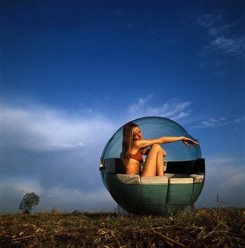 theswinginsixties:  Veruschka sitting in a field in 'Monade', a spherical plexiglass chair designed by Gianfranco Fini, 1969.