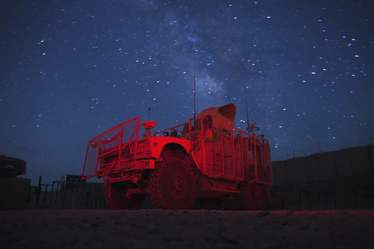 The Milky Way shines in the sky behind a Mine Resistant Ambush Protected (MRAP) vehicle parked at the entry to Forward Operating Base (FOB) Goode near the town of Gardez in Afghanistan's Paktia Province July 9, 2012. [REUTERS/Lucas Jackson] PHOTOS: The best Reuters pictures over the past 24 hours
