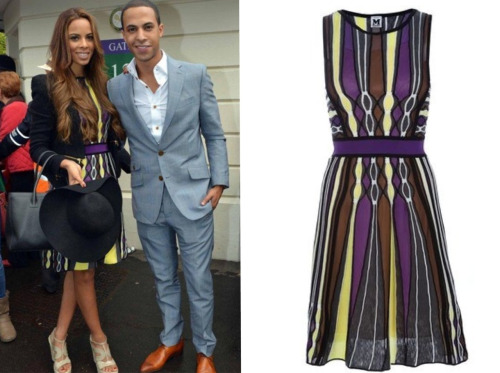 I'm feeling this M Missoni Stripe Dress.   Rochelle Wiseman completed the look with a pair of Yves Saint Laurent Espadrille Wedges, a waist black blazer and a hat.  I would have wore some sexy pumps instead but I guess the occasion called for the wedges.  Cute outfit :)