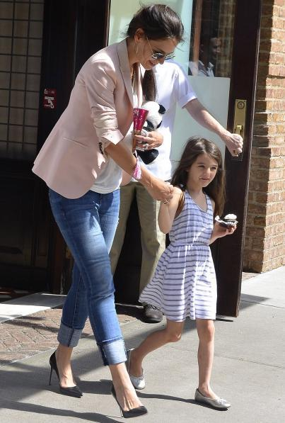 "It appears daughter Suri Cruise was the reason for the quick settlement between Tom Cruise and Katie Holmes and not the ""weapon"" as Tom thought. Details of the settlement are still not disclosed, but Tom and Katie both quickly realized that a drawn out battle would cause more harm than good to Suri."