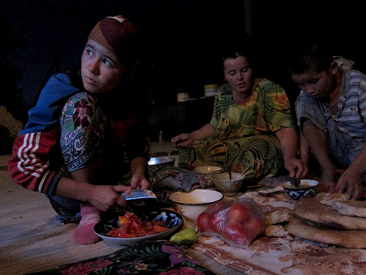 Uzbek Family Preparing Dinner In Front of the Television