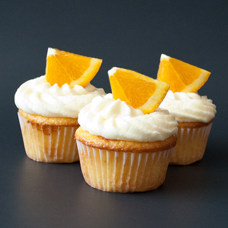 Fresh Orange Cupcakes with Orange Buttercream Frosting http://realmomkitchen.com/1785/fresh-orange-cupcakes-with-orange-buttercream-frosting/