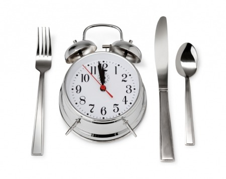 "Can You Eat Late and Still Lose Weight?  Lately we've heard the only thing that matters to your waistline is how much you eat. But there's a growing body of research that says when you eat really does make a difference in how much you weigh. ""Your body is more prone to burn fat at certain times of day and store fat at other times,"" says Satchin Panda, Ph.D., associate professor in the Regulatory Biology Laboratory at the Salk Institute in La Jolla, California. New studies reveal that to burn the most fat, you need to go 12 hours without eating — say, from 8 p.m. to 8 a.m. So it's smart to time your calorie intake accordingly. Read on for the science-backed rules that will help you use the clock to shed excess pounds. To Keep Pounds Off, Don't Eat After DarkBefore electricity and all-night diners, we humans used to spend a long stretch every night without food passing our lips. ""Staying up and eating late is a very recent phenomenon in human history,"" Panda notes. So our metabolisms are hardwired to expect a nightly fast, which is a key time for your body to burn fat. Here's how that works: During the day, your brain and muscles use some of the calories you eat for fuel, and the rest gets stored in the liver in the form of glycogen. At night, your body converts that glycogen into glucose and releases it into your bloodstream to keep your blood-sugar levels steady while you sleep. Once the stored glycogen is gone, your liver starts burning fat cells for energy. Yes, you read that right — you burn fat while you sleep. The catch: ""It takes a few hours to use up the day's glycogen stores,"" Panda says. So if you snack until midnight and sit down to your breakfast of oatmeal or eggs at 7 a.m., your body may never get the opportunity to burn any fat before you start reloading your glycogen stores again. It doesn't help that you're also likely to overeat when you're up late — indeed, night owls consume an average of 248 calories more per day than those who go to bed earlier, and most of those excess calories rack up after 8 p.m., according to a 2011 study published in the journal Obesity. ""Willpower is lower when you're sleepy,"" explains study author Kelly Baron, Ph.D., a clinical health psychologist at Northwestern University's Feinberg School of Medicine in Chicago. ""So if you're eating in the middle of the night, you're more likely to overeat and make poor food choices."" On the other hand, Panda says, ""eating only between 8 a.m. and 8 p.m., and then not eating for at least 12 hours, should give your body enough time to burn all of the stored glycogen plus some fat every night."" This could have major consequences for your weight and health — and mean you can snack more and weigh less. In a study just published in Cell Metabolism, Panda's research team found that mice that ate a high-fat diet spread out over the day and night became obese and diabetic, while mice eating the same diet but only over an eight-hour period didn't gain any weight and remained healthy. ""Fasting at night can even override most of the negative effects of an unhealthy diet,"" Panda says, ""including weight gain."" Eat Your Calories At Roughly The Same Time Every DayYou've probably heard of circadian rhythms: the internal clock that tells you when to wake and when to hit the hay. But did you know that nearly every organ in your body has its own circadian rhythm or clock, too? For example, our digestive organs — particularly the liver — are programmed to perform most efficiently during the day, Panda explains. The influence of these internal clocks may be one reason why shift workers — people who work (and eat) at night — have a higher body mass index (BMI), on average, than day workers, according to research published in the International Journal of Obesity. ""In theory, shift work should be fine because your circadian rhythms can adjust just like they do when you travel abroad,"" Panda says. ""The problem is that in order to be social, shift workers bounce back to a daytime schedule on weekends, so every organ clock gets disrupted."" It takes about one day to shift our internal clocks one hour. So if you have a night job and your bedtime jumps from 8 a.m. during the week to midnight on the weekends, your internal clocks never get the opportunity to reset themselves, which can set you up for weight gain if you're eating while your digestive organs are snoozing. ""Maintaining a regular sleep/wake schedule may be one of the most powerful ways to prevent the harmful effects of shift work,"" Panda says. Even if you're not working the night shift (or up with a baby or studying for final exams), sticking to a regular sleep and meal schedule will help keep your metabolism in peak form. Have Breakfast Within An Hour Of Waking UpResearch has found that people who eat eggs at breakfast weigh less. Other research has found that people who down a bowl of cereal at breakfast weigh less. And still other research has found that people who chase their breakfast with a slice of chocolate cake weigh less. The common denominator? You guessed it: They all ate breakfast. When you wake up in the morning, sunlight tells your brain that the day has started. Eating breakfast — breaking your night's fast — sends that same signal to the circadian rhythms in your body. Chowing shortly after you get up synchronizes these clocks and, as a result, delivers a powerful metabolic jumpstart, Panda says. That means you'll more efficiently use nutrients all day. There's one caveat: If you eat a big dinner at 11 p.m. one night, it's actually smart to skip the early morning meal in order to fit in a 12-hour fast. ""The idea that we need to have breakfast every single day has become so ingrained in people's minds that for late-night eaters, it means they end up eating around the clock,"" Panda says. If your last meal was a plate of bar fries at midnight, push your first meal the next day to noon. (Consider it lunch if you're returning to a regular schedule or breakfast if you expect a repeat late-night eating event.)How big should your a.m. dish be? It depends whether you're counting calories. ""Having a big breakfast can lead to feeling less deprived overall, but you have to take total calories into account,"" Baron explains. A recent study from Tel Aviv University looked at women on a strict 1,400-calorie-a-day plan and found that those who had a 600-calorie breakfast high in protein and carbs that included dessert (like chocolate!) not only lost more weight on average than the ones who ate a 300-calorie low-carb breakfast, but they also had fewer cravings and were better at keeping off the weight. However, if you're not tallying your total daily calories — balancing a big breakfast with a smaller lunch and dinner — eating a lot first thing in the morning could cause you to take in too many calories, and subsequently put on weight. Good advice for all: Simply include protein (like yogurt or nuts) in your morning meal. Several studies have found that higher-protein breakfasts can help you feel full and make you less likely to overeat all day — and into the night. Source: Paige Greenfield, www.huffingtonpost.com, www.health.com"