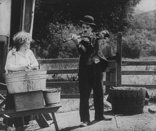 Charlie and Edna Purviance in the Vagabond released on this day, by Mutual Studios, c.1916