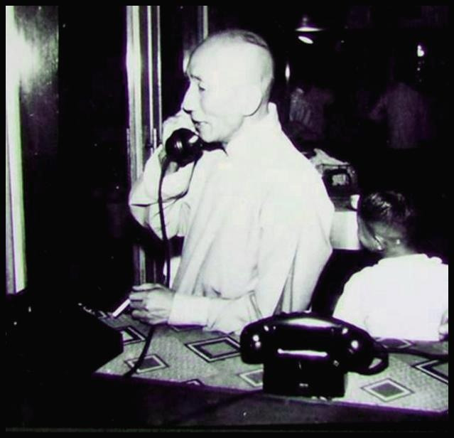 Grandmaster Yip Man talking on the phone.