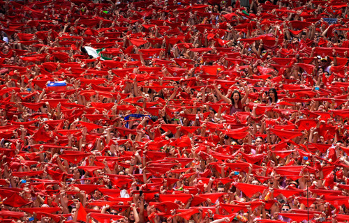 Revelers hold up red scarves during the start of the San Fermin Festival in Pamplona July 6, 2012. (Photo by Vincent West, Reuters) The Atlantic has put together some brilliant images captured during the popular festival.