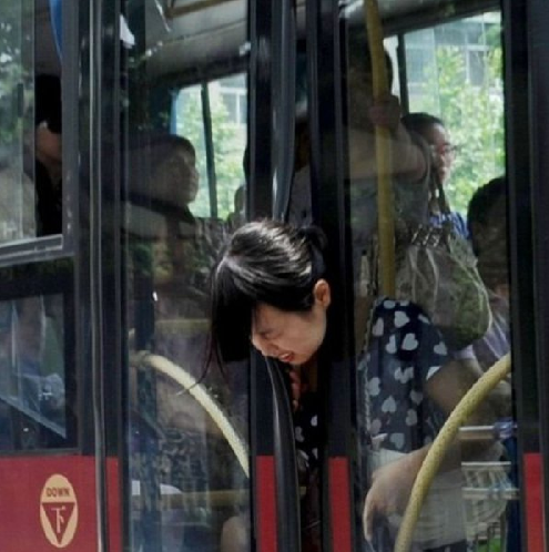 Woman's Head Stuck in Doors Look! The trolley is giving birth!