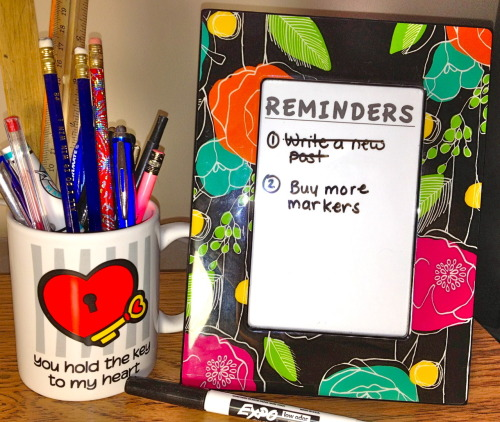Organization Tip: Use a picture frame for your desk.  Add a piece of paper inside.  Use a dry erase marker to jot down important reminders for yourself.  No more need for sticky notes all over your desk.
