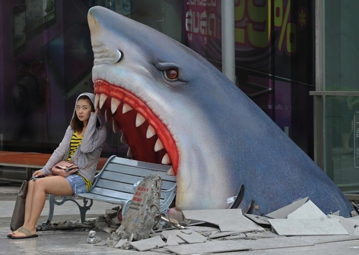 KILLER BENCH We're loving this large art display of a Shark breaking through the cement to devour whoever is sitting on the bench. The installation is currently at a shopping mall in Bangkok. photo by Pornchai Kittiwongsakul (AFP/Getty Images) via Baltimore Sun