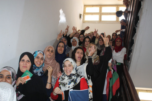 Female voters sing while waiting in line to vote. (Samia Mahgoub / UNDP)  Libya GNC Elections- Voting Day 07.07.2012 (United Nations Development Programme)