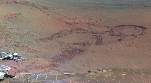 ecocides:  Mars images captured by Nasa's rover Opportunity  It could be the Sahara or Egypt's Western Desert, but this sand-covered crater is the latest image from Mars. The picture was taken from US space agency Nasa's Mars exploration rover, Opportunity, close to where the robotic unit spent the winter analysing soil and air samples. The picture shows the explorer's deck and solar panels, tracks it had previously made and a crater that was created by an impact billions of years ago. Opportunity has now spent 3,000 Martian days on Mars (eight and a half Earth years), and Nasa has consistently had a robot there for 15 years. Mars Pathfinder landed on 4 July 1997; Nasa's Mars Global Surveyor orbiter reached the planet while Pathfinder was still active; and Global Surveyor overlapped the active missions of the Mars Odyssey orbiter and Opportunity. The latter two are both still in service. [Keep reading | images: Nasa]  Desert Planet.
