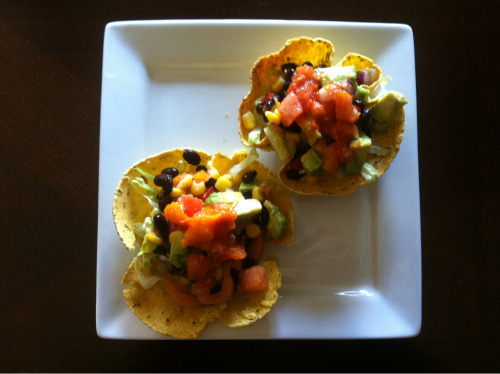 vegan-fit-life:  homemade mini vegan tostadas that are so filling and full of protein   Ingredients (All Organic): - sprouted Food For Life corn tortillas - diced tomatoes  - sweet corn - black beans - red onions diced - roasted bell peppers diced - avocado cubed - shredded romaine How To Make: In a small oven safe bowl place tortillas in oven to crisp into cups on 350 for twenty minutes Dice and shred all ingredients and scoop into cups, top with avocado and some salsa and a pinch of salt