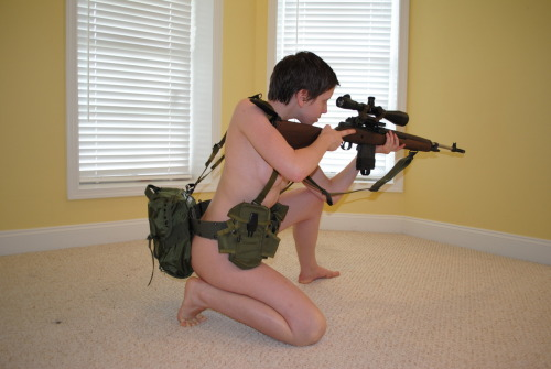 gjallarhornallewerk:  See, itty bitty girl, big-ass gat. Forgive the walls.  Mom decided to paint the basement when I went off to basic.  It's actually pretty nice, but shitty as a background and I was unprepared and in a hurry.  mmm dat M1A, I love the original wood on those, reminds me of the M1 Garand.