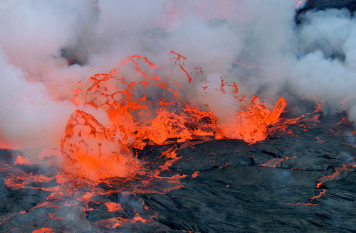 Mount Nyiragongo is a stratovolcano situated in the Virunga Mountains of the Albertine Rift inside Virunga National Park, in the Democratic Republic of the Congo. The volcano has an elevation of 3,470 m (11,385 ft). The main crater is about two km wide and usually contains a lava lake (see photo) that has at times been the most voluminous known lava lake in recent history. The depth of the lava lake varies considerably. Not much is known about how long the volcano has been erupting, but since 1882, it has erupted at least 34 times with the two most recent eruptions occurring in 1977 and 2002, both resulting in destruction of nearby human habitats and loss of lives, mostly due to asphyxiation by carbon dioxide. Activity at Nyiragongo is ongoing, but currently confined to the crater. Nyiragongo and nearby Nyamuragira are together responsible for 40% of Africa's historical volcanic eruptions. The Democratic Republic of Congo is home to a total of five different active and extinct volcanoes.