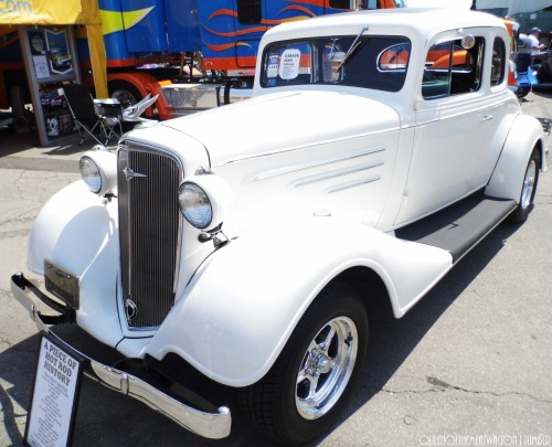 "On plaque leaning on bumper :""1937 Chevy Master. X-drag car, then restored in 1971. 9 month build. All steel car.283-V8. 400 turbo tran. 1959 Olds rear end. Front end old school mix. Drum brakes. All wood in doors & body. Vintage a/c. Sun gages. Lacquered paint-cotillion. Original paint, pin stripes. Interior-root beer. Cadi steering column. Olds duelgate shifter. 3 owners since car was restored. P.S Car won best use of color in 1972 NSRA show in Michigan that year.""  15th Goodguys PPG NationalsColumbus, Ohio(7.7.11)"