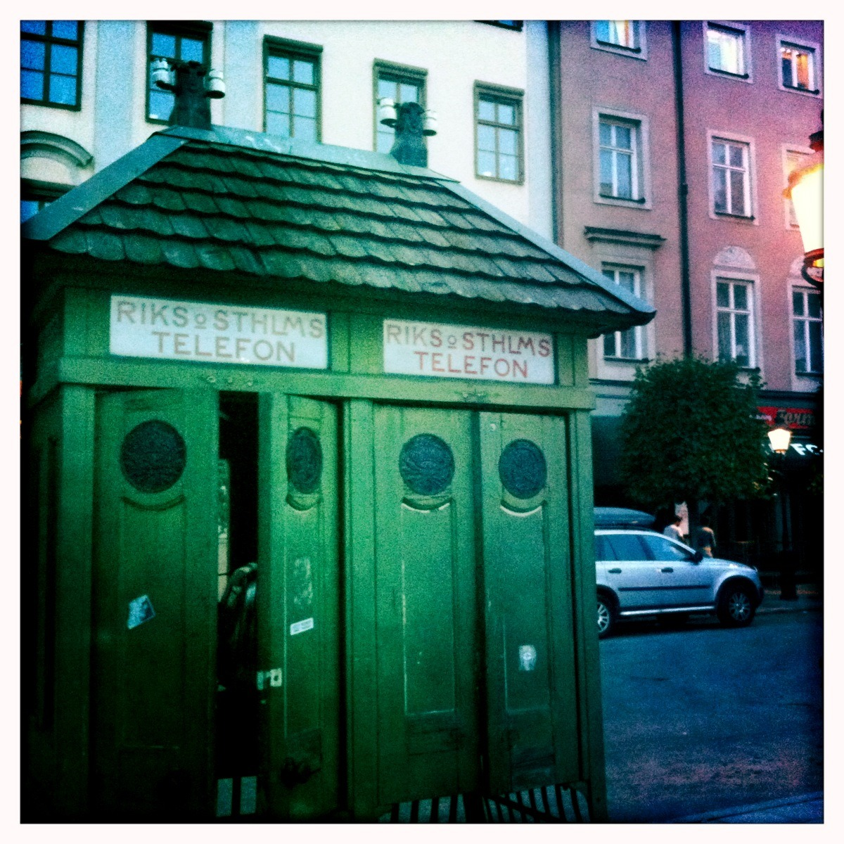 Beautiful wooden phone booth in Stockholm resembles Japanese temple of solitary contemplation.
