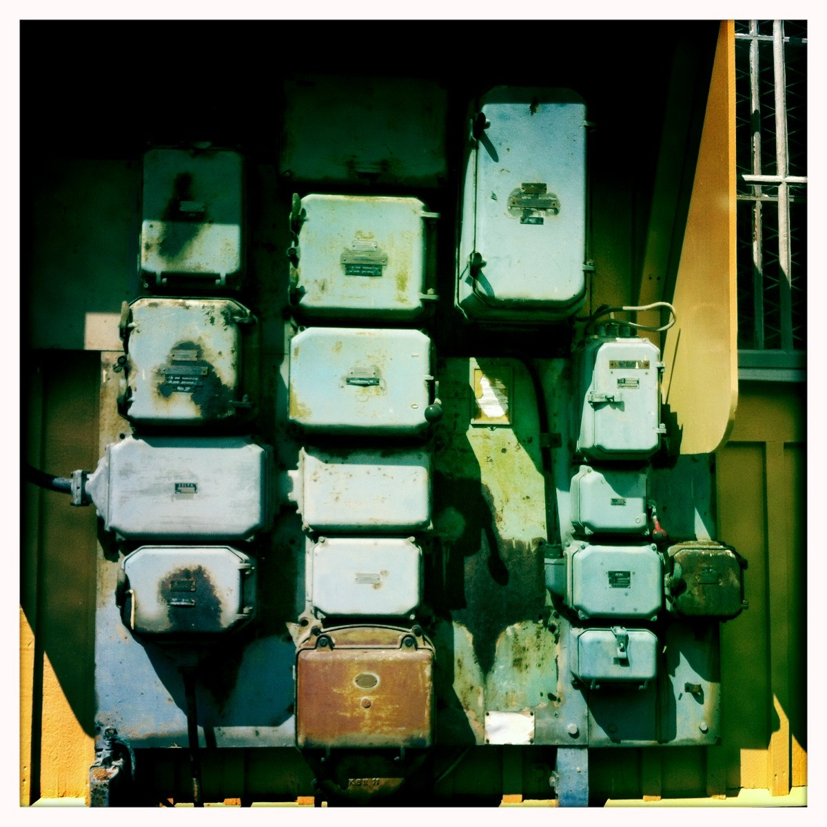 In an alleyway behind the Post office I found the 1927 fuse box that controls all of Stockholm's electricity. It was guarded only by a slack-eyed pigeon.