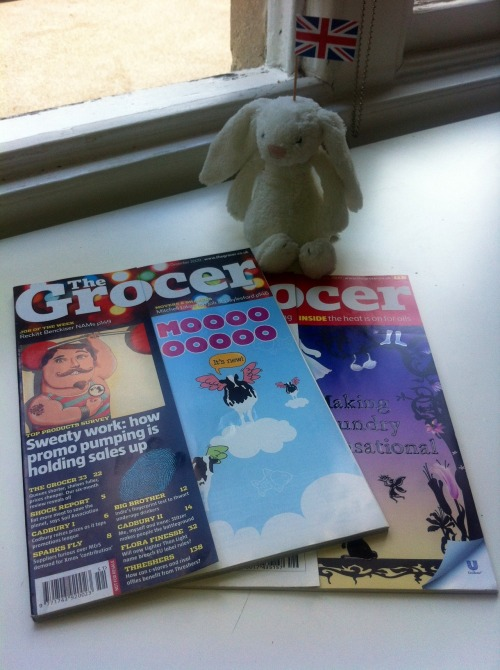 The Blow Bunny.  Here, sat with our award winning Grocer front covers is the Blow Bunny. We found him by the side of the road, lost, soaked to the fur, and homeless. Since taking him under our wing he's brought joy and happiness to the agency. He can currently be found sat by the water cooler, ease dropping with his big bunny ears on all of the office gossip.