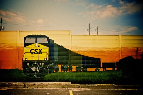 "A whimsical train mural on the wall at the ""Hump Tower"" at CSX's Tilford Yard in Atlanta. Taken on Dad's last day of work. Shot with my Pentax K1000, using Fuji Pro 400H."
