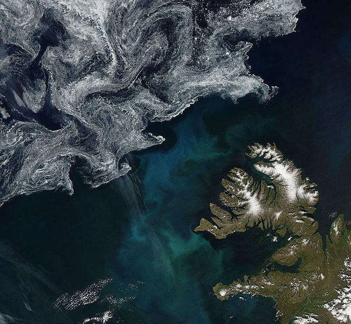 Earth from NASA  Swirling sea ice and a phytoplankton bloom captured off the coast of Iceland by NASA's Aqua satellite on July 9.