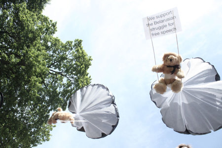 "Belarus: Teddy Bears for Free Speech via GOOD:  The small former-Soviet republic Belarus is considered to be Europe's last surviving dictatorship. Protestors and the political opposition arejailed. Journalists are harassed. But that doesn't mean stories from that small, landlocked nation—or the dissidents trying to bring democracy and free speech there—get much airtime in the West. Last week the Swedish advertising agency Studio Total attempted to do something about the relative silence surrounding Belarus by staging a high profile, and highly dangerous stunt designed to draw attention to the issue from the outside. The group flew a plane into Belarusian airpsace and unloaded more than a thousand parachute-strapped teddy bears over the village of Ivyanets and Minsk, the capitol. The toys glided to the ground with signs that read ""We support the Belarusian struggle for free speech."" Afterward, the plane crossed the border for safety in Lithuania. Keep Reading  FJP: Woah."