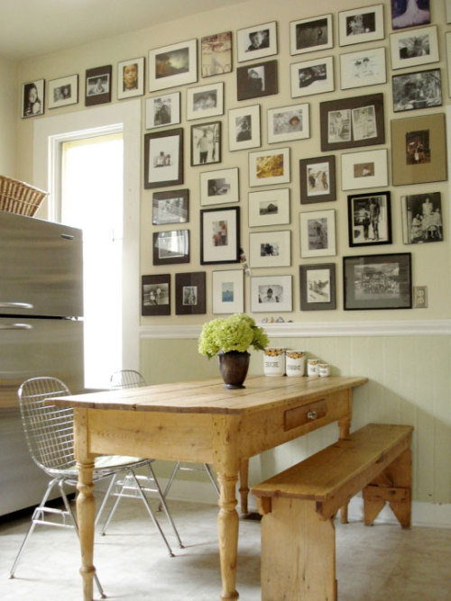 interiors-and-exteriors:  Love the family portrait wall and how none of the frames match.