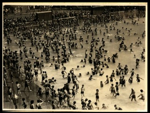 McCarren Park Pool, July 1944.  More Robert Moses-affiliated NYC swimming pools here.