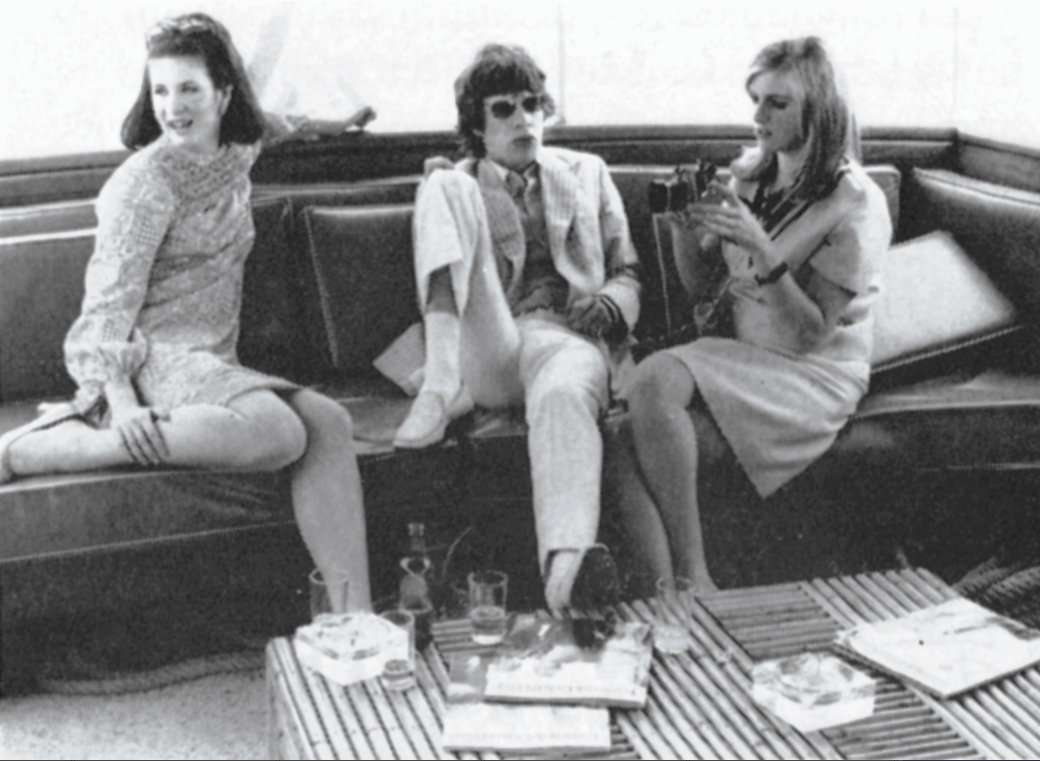 In his glory days, Mick Jagger lounges with Christina Berlin and Linda Eastman. The Rolling Stones celebrate their 50th year in 2012. Photo courtesy of Stephanie Cardinale/People Avenue/Corbis in Town & Country August 2012.