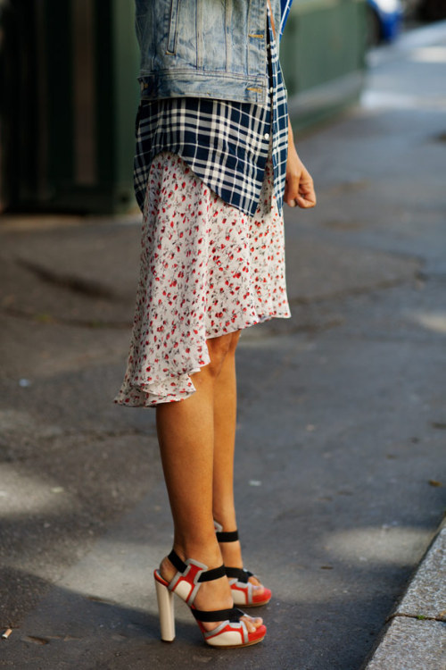 Try mixing a tomboy flannel with feminine floral for a uniquely mixed ensemble like this look, photographed by the Sartorialist.