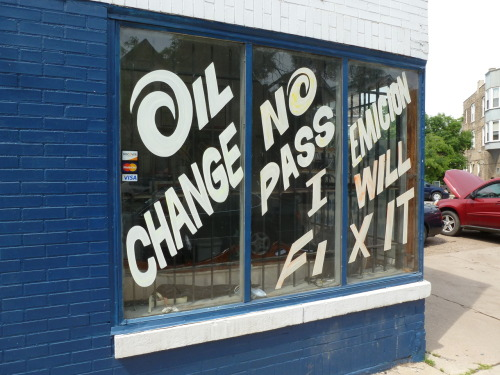 Cut vinyl lettering on the window of a Chicago oil change and emissions repair shop. Whoever cut those 'O's looked like they were really having a good time. This photo was taken in June, 2011.