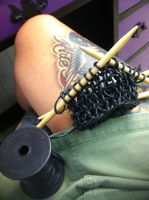 Oh, you know, just knitting a gauntlet with leather cord, like a boss.