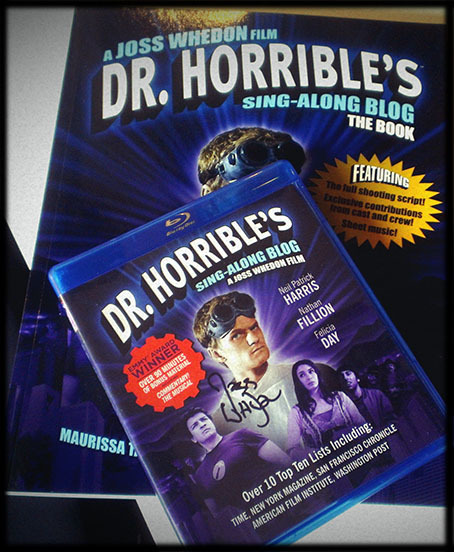 comicconvos:   *Give away!* We're giving away a Blu-ray DVD of Dr. Horrible's Sing-Along Blog signed by director/writer Joss Whedon (Who also directed/wrote the Avengers movie) along with a Dr. Horrible book that includes the sheet music for songs, memories from Joss and some of the cast, and the shooting script among many other things.  You *must* be following ComiConvos in order to win these You can reblog as much as you like Likes will not be counted On July 25th we'll choose a winner through a name generator. May the Odds be ever in your favor!