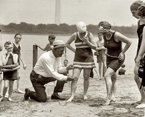 "turnofthecentury:  June 30, 1922. Washington policeman Bill Norton measuring the distance between knee and suit at the Tidal Basin bathing beach after Col. Sherrill, Superintendent of Public Buildings and Grounds, issued an order that suits not be over six inches above the knee."" National Photo Co.  from Shorpy [see also 1933 measuring @ so30s :]"
