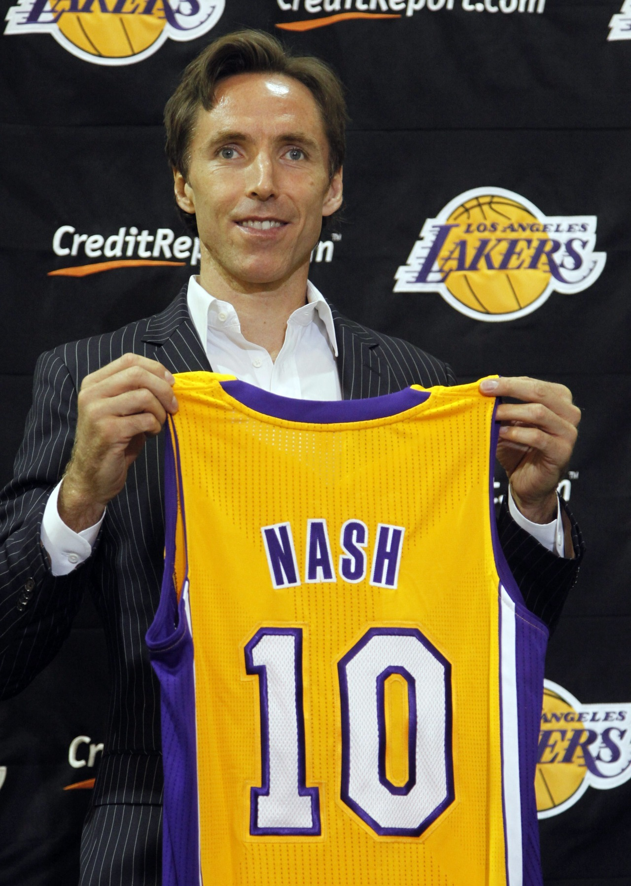 Now you know it's real: Last week, Steve Nash was traded to the L.A. Lakers. This week, he tried on his new jersey at a news conference in California. It's all happening so fast.