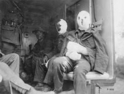 midnight-gallery:  Mustard Gas VictimsThe extensive bandages on these wounded Canadian soldiers may indicate that they have suffered the effects of flame or mustard gas. Mustard gas burned the lungs, but also caused serious external blisters and disfigurement.George Metcalf Archival Collection.