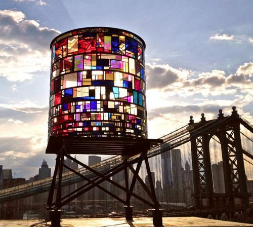 """Watertower,"" Tom Fruin ©2012  found plexiglas, steel, bolts 20 x 10 x 10 feet  Location: DUMBO, Brooklyn USA ""Situated on the rooftop of 20 Jay Street the sculpture is viewable from the parks and streets of Dumbo, the Brooklyn and Manhattan Bridges, FDR Drive and Lower Manhattan. The prime viewing locations are the Brooklyn Bridge Park at Washington Street(see map), and the Manhattan Bridge bike path."""