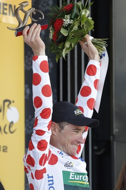 Nice! fuckyeahcycling:  Stage winner Thomas Voeckler of France, wearing the best climber's dotted jersey, holds the trophy on the podium of the 10th stage of the Tour de France cycling race over 194.5 kilometers (120.9 miles) with start in Macon and finish in Bellegarde-sur-Valserine, France, Wednesday July 11, 2012. (via Photo from AP Photo)