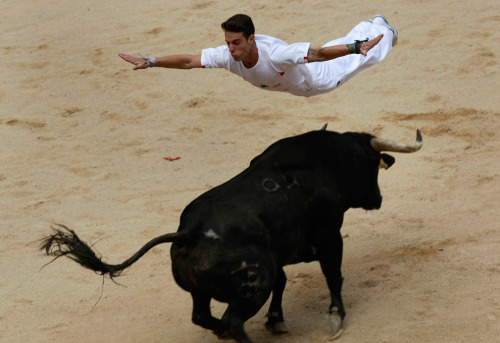From today's running of the bulls photo gallery at The Big Picture.