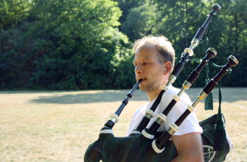 Bagpipe player in the park.